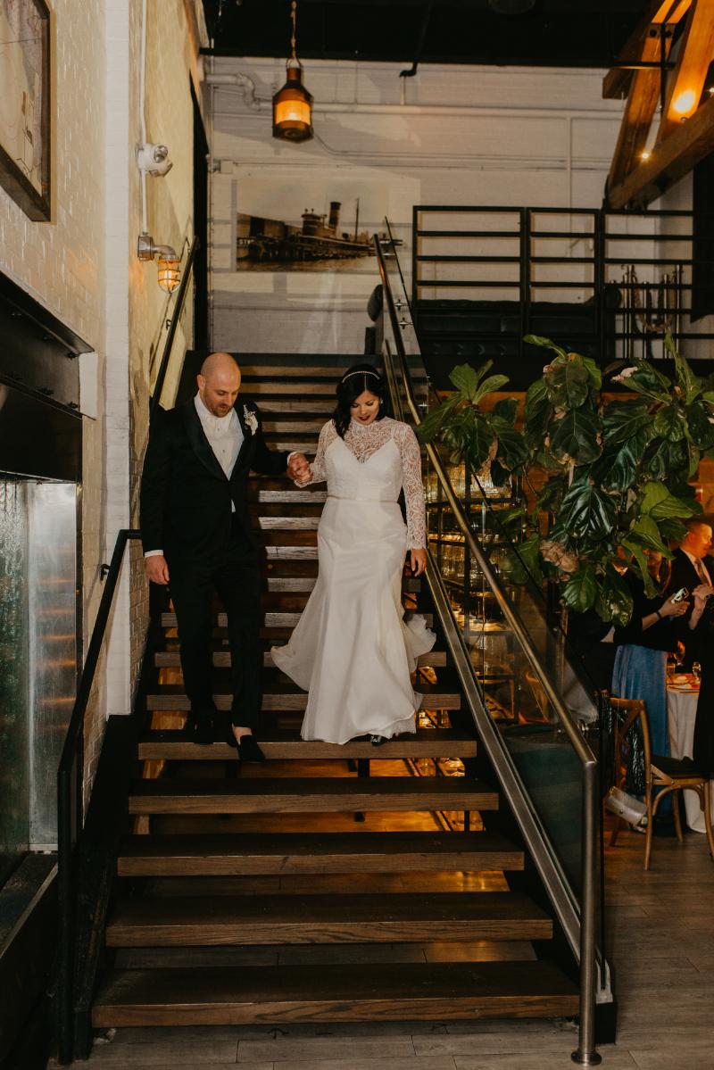 bride and groom enter reception venue