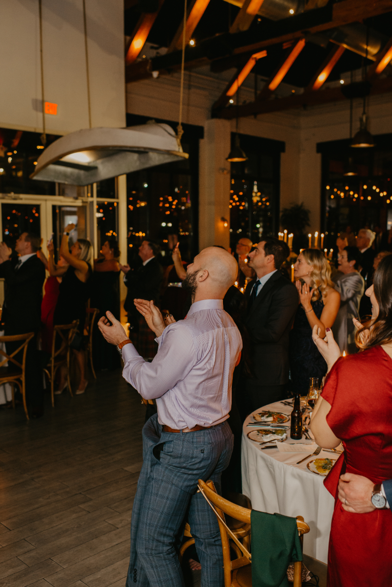 guests clap as bride and groom enter