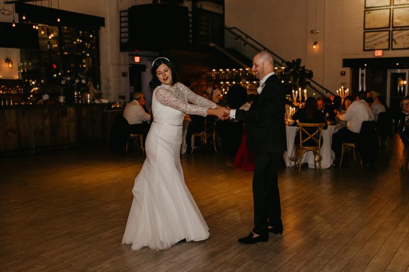 Fun bride and groom dance