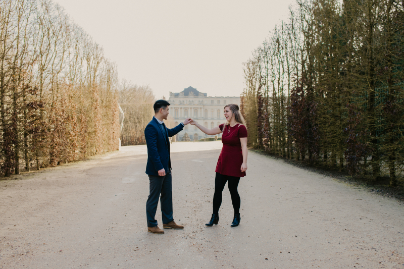 Engagement photos in front of the Palace of Versailles