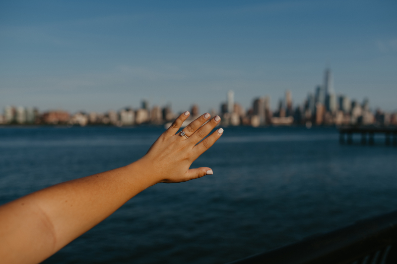Engagement ring against NYC skyline