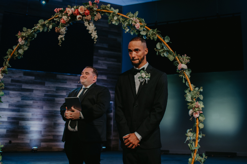 groom looking at bride down the aisle at new jersey church wedding