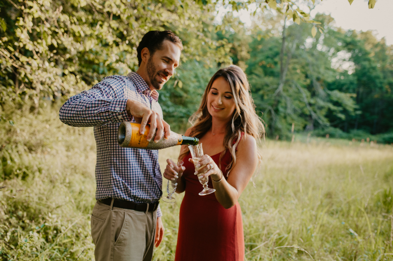 Champagne photos outside for engagement photos