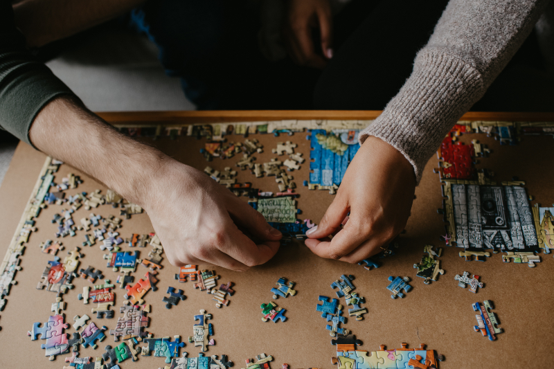 Engagement photos at home playing a puzzle