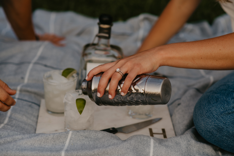 fun engagement photos making margaritas in liberty state park