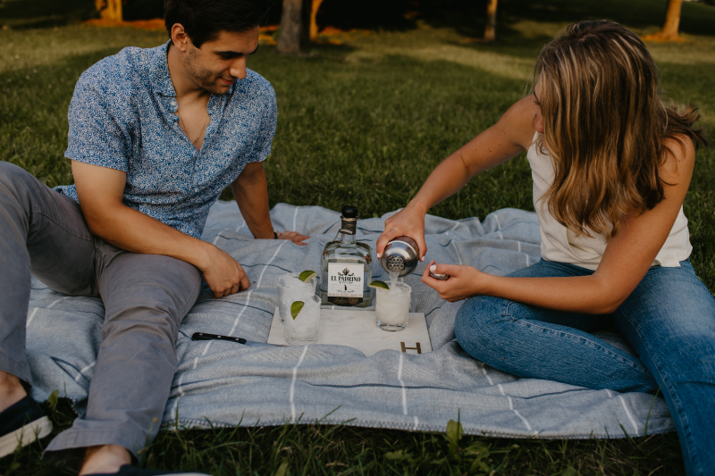 Unique engagement photo shoot in New Jersey making margaritas outside