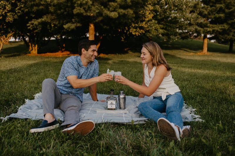 Engagement photos making margaritas outside