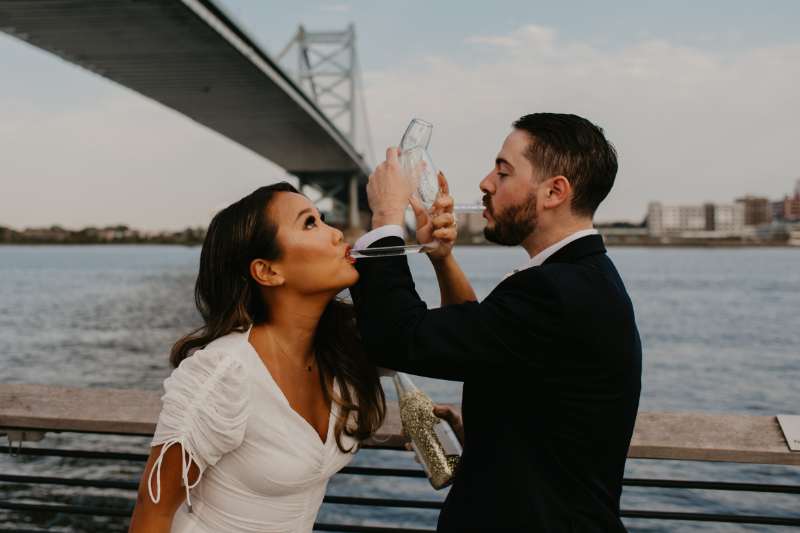 Popping champagne in wedding photos