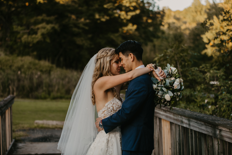 pose ideas where bride is putting her hands over grooms shoulder