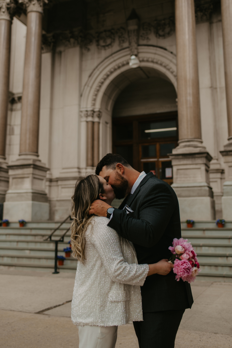 Bride and Groom Pose in front of Jersey City City Hall
