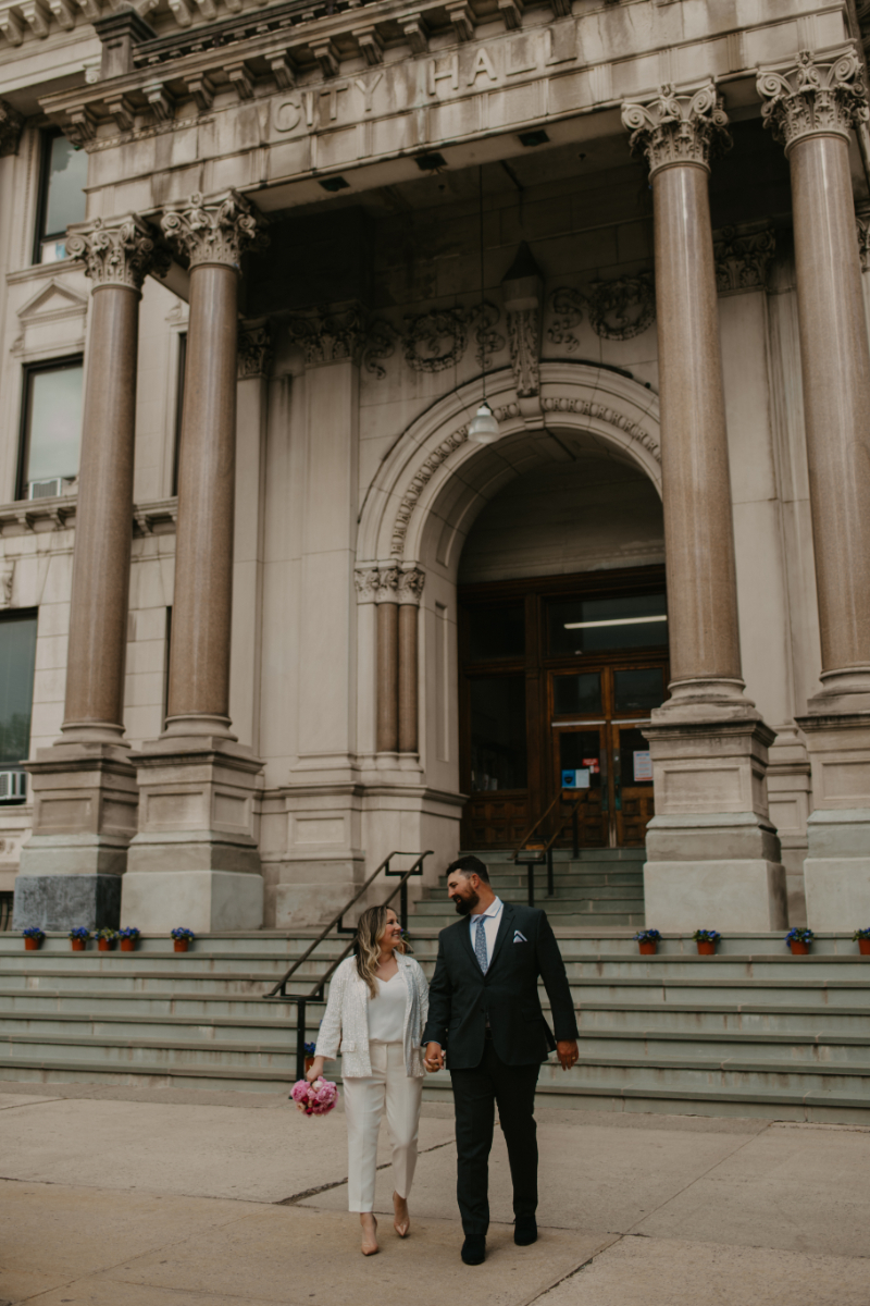 Bride and Groom pose outside of City Hall