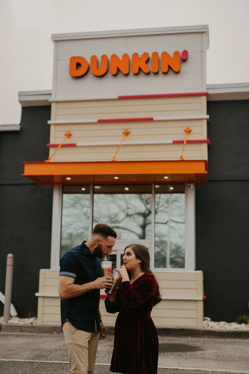 Engagement photos outside Dunkin Donuts