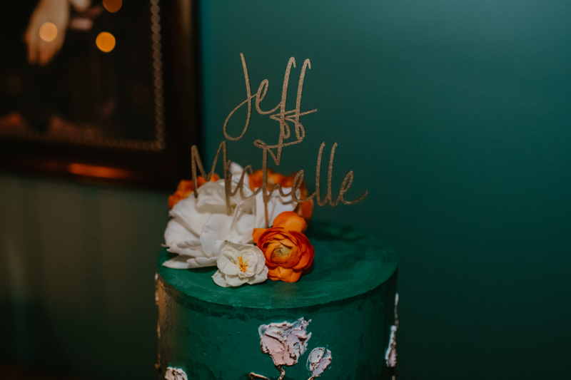 Teal Colourful wedding cake with gold cake topper