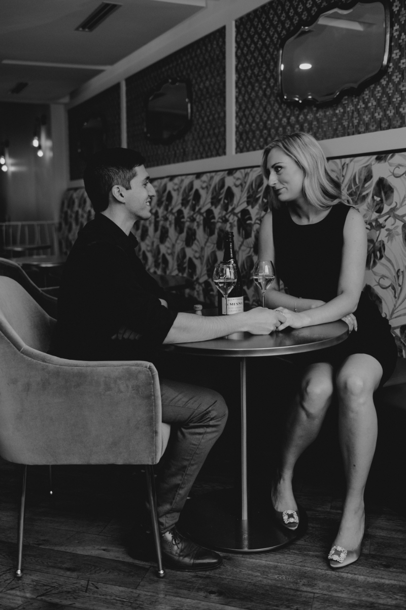 Pittsburgh Engagement Photos at a local restaurant with wine