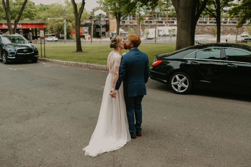 Bride and groom kiss outside of church ceremony