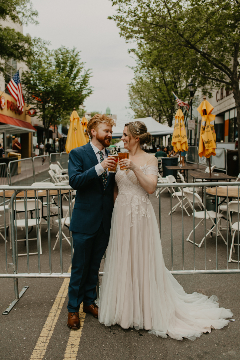 Bride and groom with pints of beer