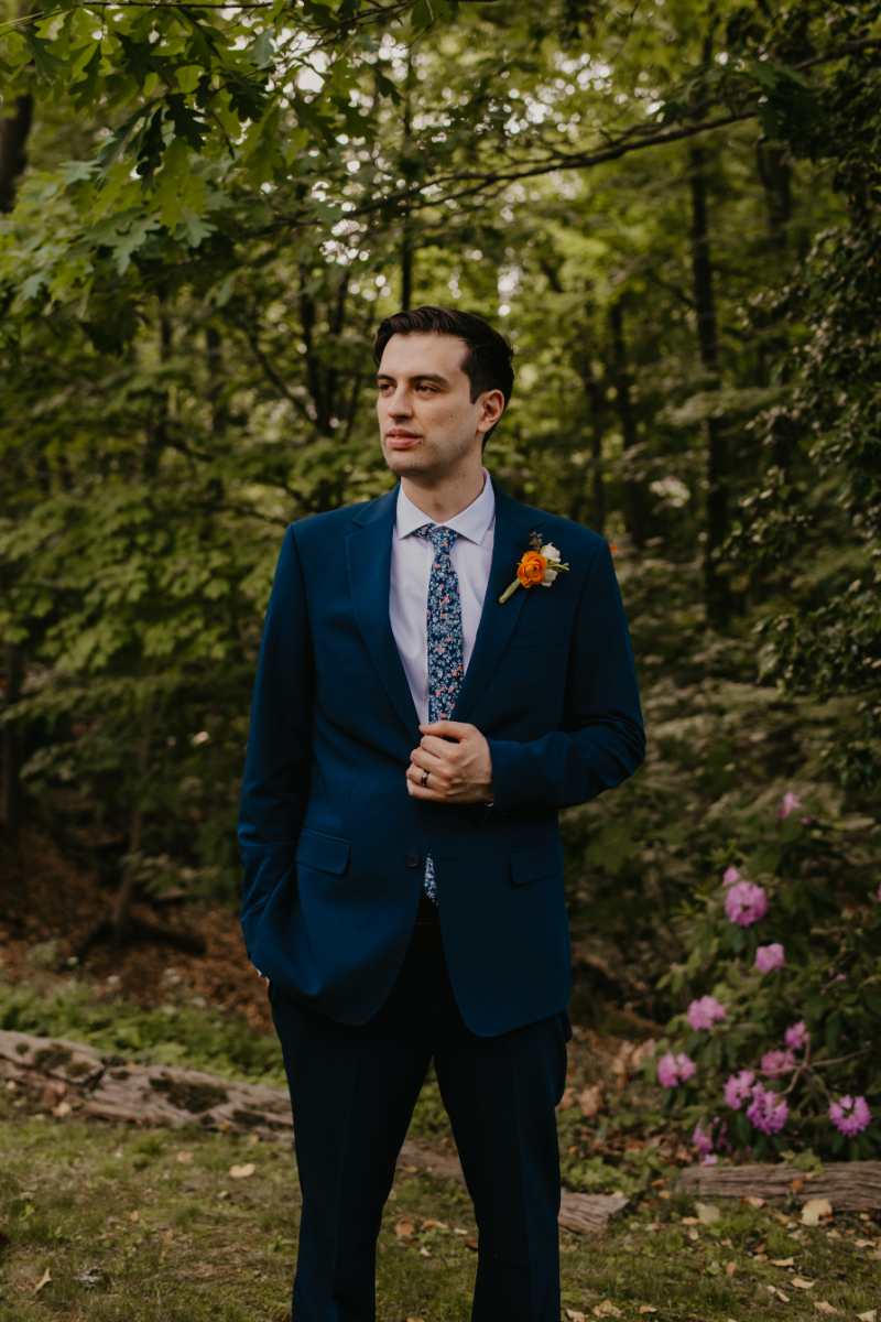 Solo shot of Groom outdoors at New Jersey home wedding