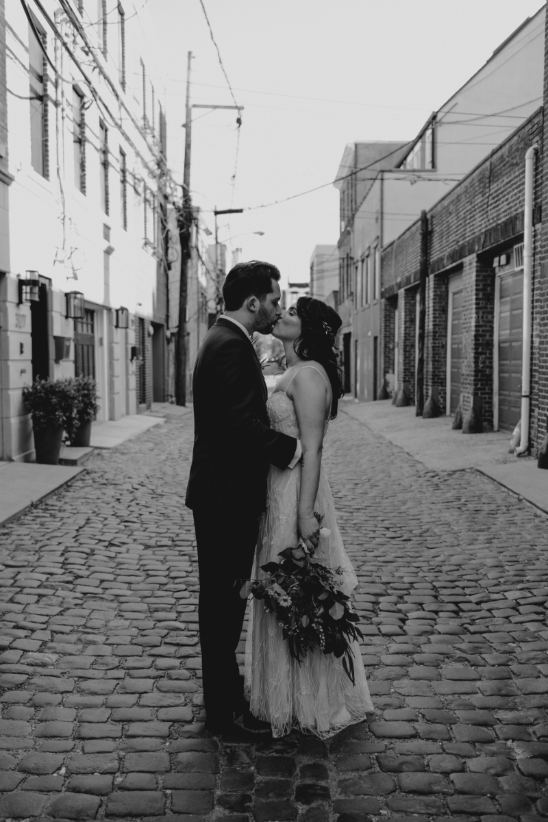 Bride and Groom kiss on Court Street