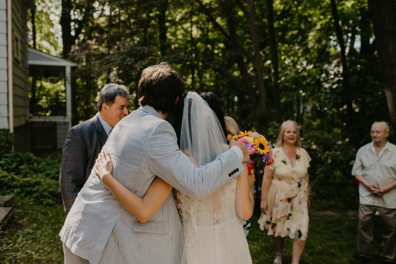 Bride hugs guests after her wedding ceremony