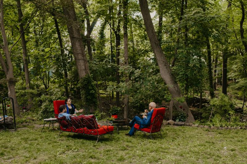 Red lounge furniture at backyard wedding