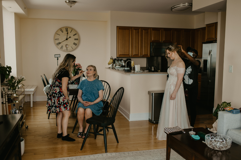 Getting ready photos at home with bride