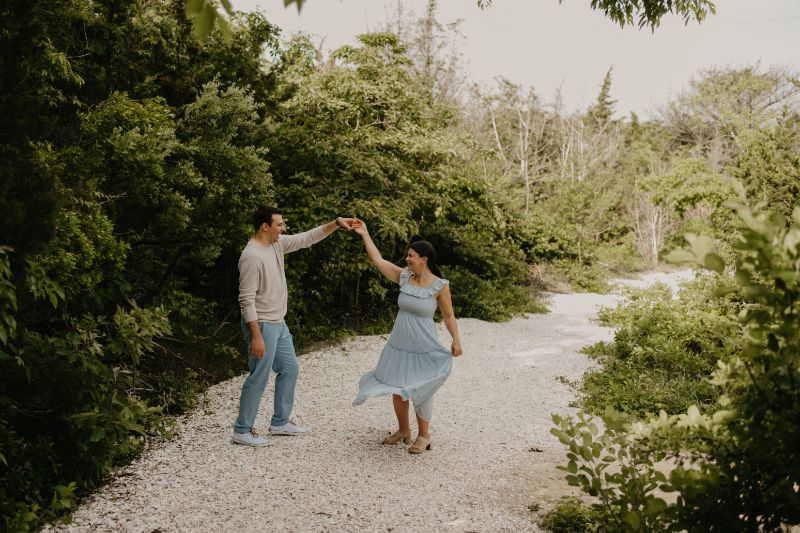 Dancing in the Woods Engagement Photoshoot. Lusciously Green Couples Professionally taken Pictures by a Long Beach Island Photographer.