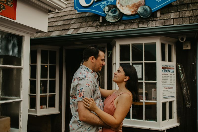 Staring into eachothers eyes, Romantic Photos taken outside Small Town Shop by the beach.