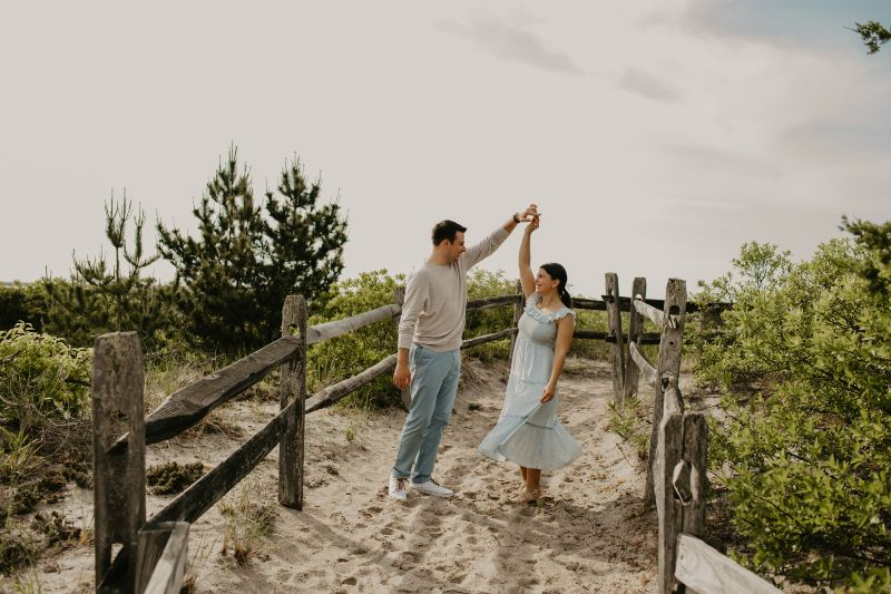 Dancing with Love in their eyes on a sandy path in Long Beach Island.