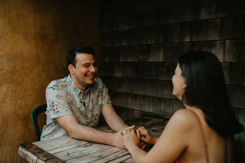 Smiling Happily for the future Wedding. Engagement Inspirational Sit Down Photos.