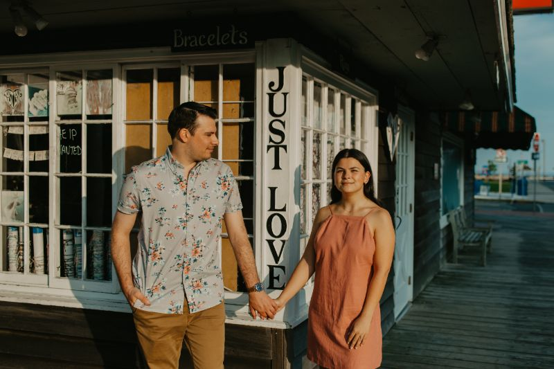 Just Love, Engagement Pictures by the beach. Long Beach Island Boardwalk Shops and Poses.