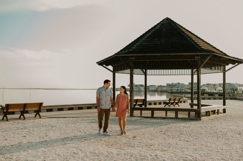 Gazebo Engagement Beach Photos at Long Beach Island. PInk Sundress and Colorful shirt to celebrate the Wedding to come!