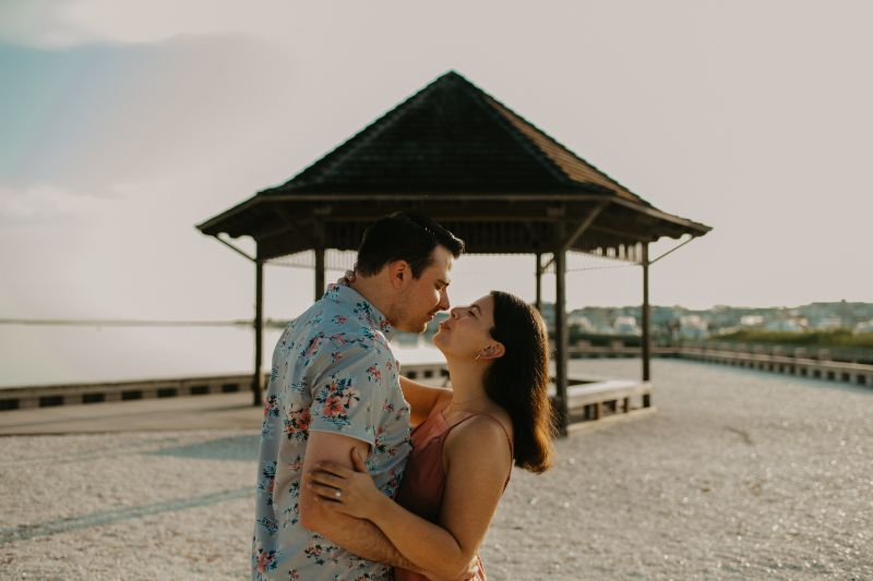 Intimate and Romantic Gaze in this  Long Beach Island photoshoot, with a Rustic Gazebo in the background.