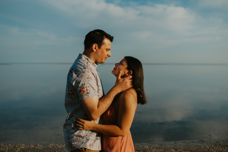 Crystal Clear Blue Water, Engagement pictures on Long Beach Island. Blue Skies with Fluffy clouds photoshoot.