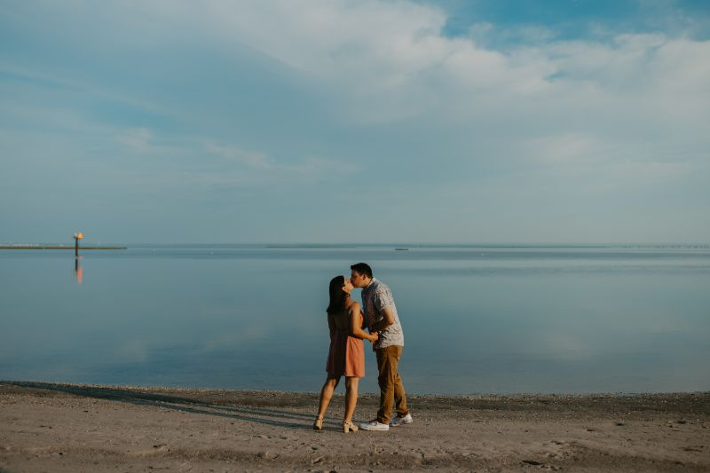 Beach views with stunning reflective waters in this Long Island Beach Engagement Photoshoot.