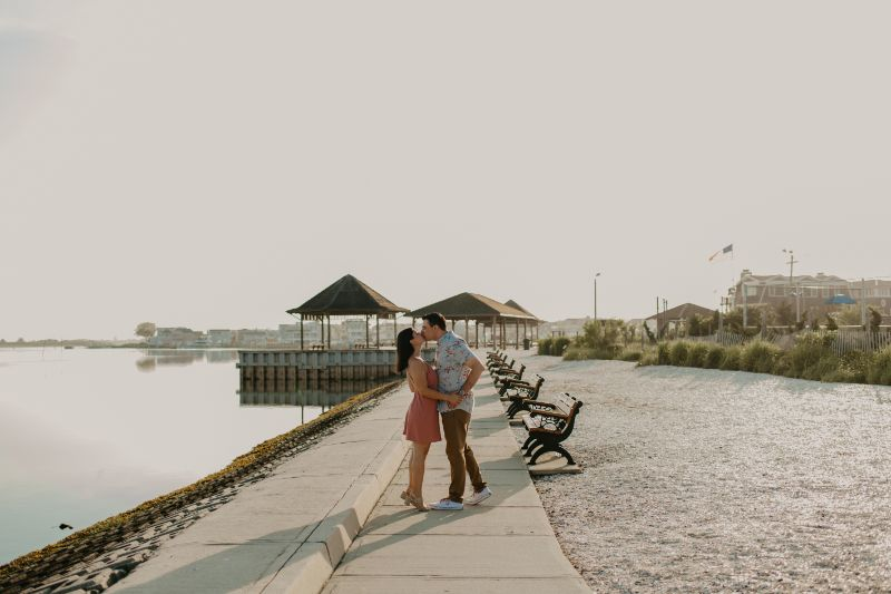 Practicing those kisses for the big Wedding Day! Cute Engagement Photoshoot by the beach with this happy Couple in Long Beach Island.