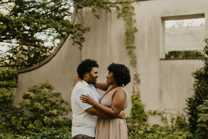 Staring deeply into a future with your fiancé at Cross Estate Gardens. Truly romantic and genuine Engagement Photos.