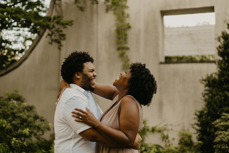 Laughing until you can't anymore at Cross Estate Gardens for fun Engagement Photos.